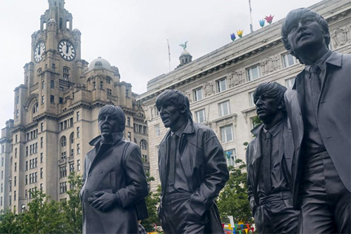 The statue of the Beatles in front of Liverpool's Royal Liver Building, a mutual that provided more than a century of help to millions of the city's residents. [photo: Co-operative News]