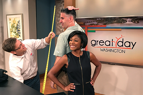Twins Ace Hardware co-founders Craig and Jeff Smith demonstrate one of their must-have tools on the set of Great Day Washington with host Markette Sheppard.