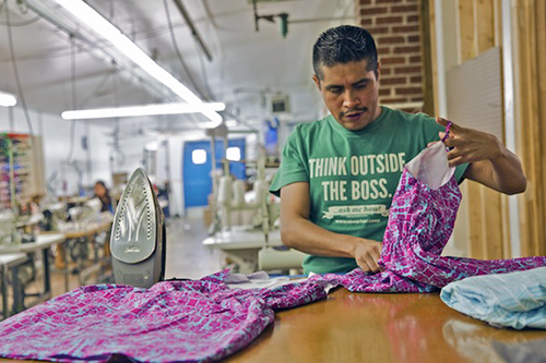 The first national legislation to address worker cooperatives evens access to SBA loans, paving the way for more success stories like Opportunity Threads, an immigrant-owned textile factory in North Carolina. [photo courtesy USFWC]