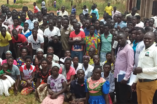 Young people at the first co-op registration meeting in Kole, Uganda.